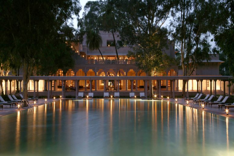 AMANBAGH Pool and main building at night